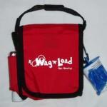 Dog bag has side clip for dog poop bags dispenser